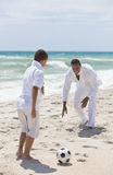 African American Family Playing Football on Beach Royalty Free Stock Photography
