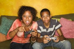 African-American family playing video game Stock Photo