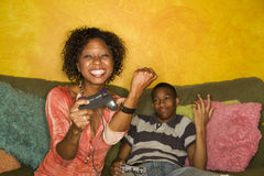 African-American family playing video game Royalty Free Stock Photos