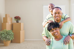 African American Family In Room with Packed Moving Boxes Royalty Free Stock Photography