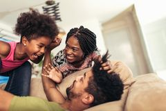 African american family spending time together at home. They are having fun stock photo
