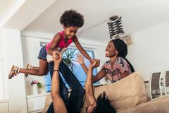 African american family spending time together at home. stock photo