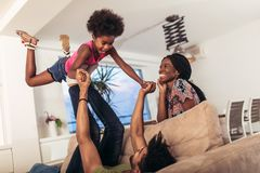 African american family spending time together at home. They are having fun royalty free stock photos