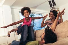 African american family spending time together at home. They are having fun stock image