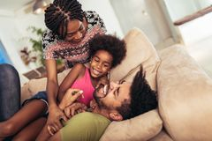 African american family spending time together at home. They are having fun royalty free stock photography