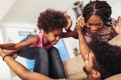 African american family spending time together at home. They are having fun stock photos