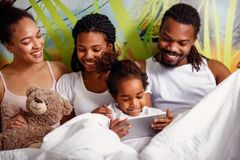 African American family spending time together with tablet in th royalty free stock photos