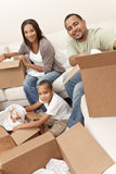 African American Family Unpacking Boxes Move Hom stock images