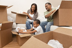 African American Family Unpacking Moving Boxes