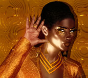 African American Fashion Beauty with glitter cosmetics and black background. African American Fashion Beauty with glitter cosmetics. Perfect for expressing Stock Images
