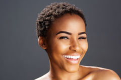 African american fashion model smiling. Close up beauty portrait of african american fashion model smiling Royalty Free Stock Images