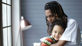 African american father embracing his little son stock footage