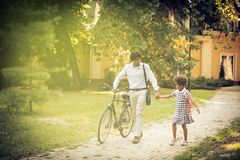 I love school days. African American father and his daughter walking trough park and talking royalty free stock photos