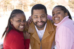 African American father and his young daughters. Royalty Free Stock Image