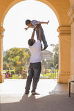 African American Father Lifting Mixed Race Son Royalty Free Stock Photo