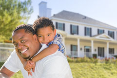 African American Father and Mixed Race Son, House Behind Royalty Free Stock Images