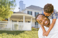 African American Father and Mixed Race Son, House Behind Stock Images