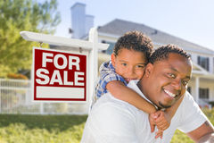 African American Father and Mixed Race Son, Sale Sign, House Stock Photo
