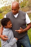 African American father parenting his son. Royalty Free Stock Photo