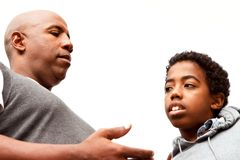 African American father parenting his son. African American father parenting his son outside Royalty Free Stock Image