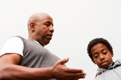 African American father parenting his son. Stock Images