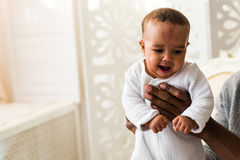 African American Father Playing With mixed race Baby Son Stock Photos