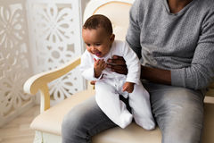 African American Father Playing With mixed race Baby Son. Father Playing With Baby Son At Home Stock Photos