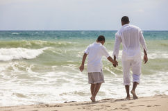 African American Father Son Family on Beach Royalty Free Stock Photo