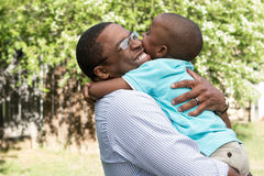 African American father and son hugging. Royalty Free Stock Photos