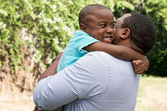 African American father and son hugging. Royalty Free Stock Image