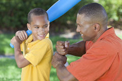 African American Father & Son Playing Baseball. African American men & boy child, father and son playing baseball together outside Stock Images
