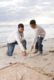 African-American father and son playing on beach. African-American father and ten year old son playing on beach Royalty Free Stock Images