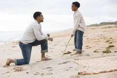 African-American father and son playing on beach. African-American father and ten year old son playing on beach Royalty Free Stock Image