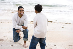 African-American father and son playing on beach Royalty Free Stock Photo