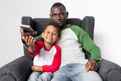 Father and son watching tv Stock Photo