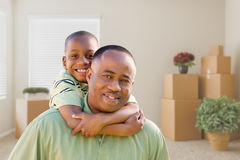 African American Father and Son In Room with Packed Moving Boxes Stock Photos