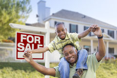 African American Father and Son, Sale Sign and Home Stock Photos
