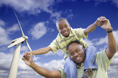 African American Father and Son with Wind Turbine Stock Images