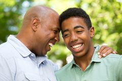 African American father and teen son. African American father talking to his teen son Stock Photography