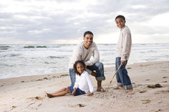 African-American father and two children on beach Royalty Free Stock Photo