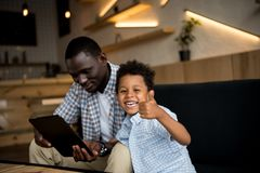 Father and son with digital tablet Royalty Free Stock Images