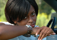 African american female. Sitting in a truck stock image
