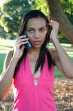 African American Female. Beautiful African American female talking on the phone Stock Photo