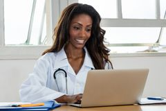 African american female doctor at computer royalty free stock images