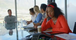 African american female executive sleeping during meeting in modern office 4k. Front view of young African american female executive falling asleep during stock footage