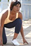 African-American Female Exercising, Stretching Stock Photo