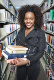 African American Female Holding Stack Of Books Stock Photography
