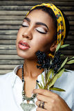 African american  female model with flower Royalty Free Stock Photo