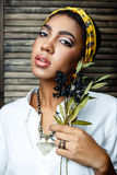 African american  female model with flower Stock Images