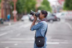 African American female photographer with Canon camera stock images